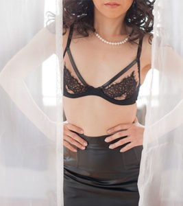 Toronto Dominatrix & Asian Seductress Miss Ava Azami (leather bra and skirt with pearl necklace)